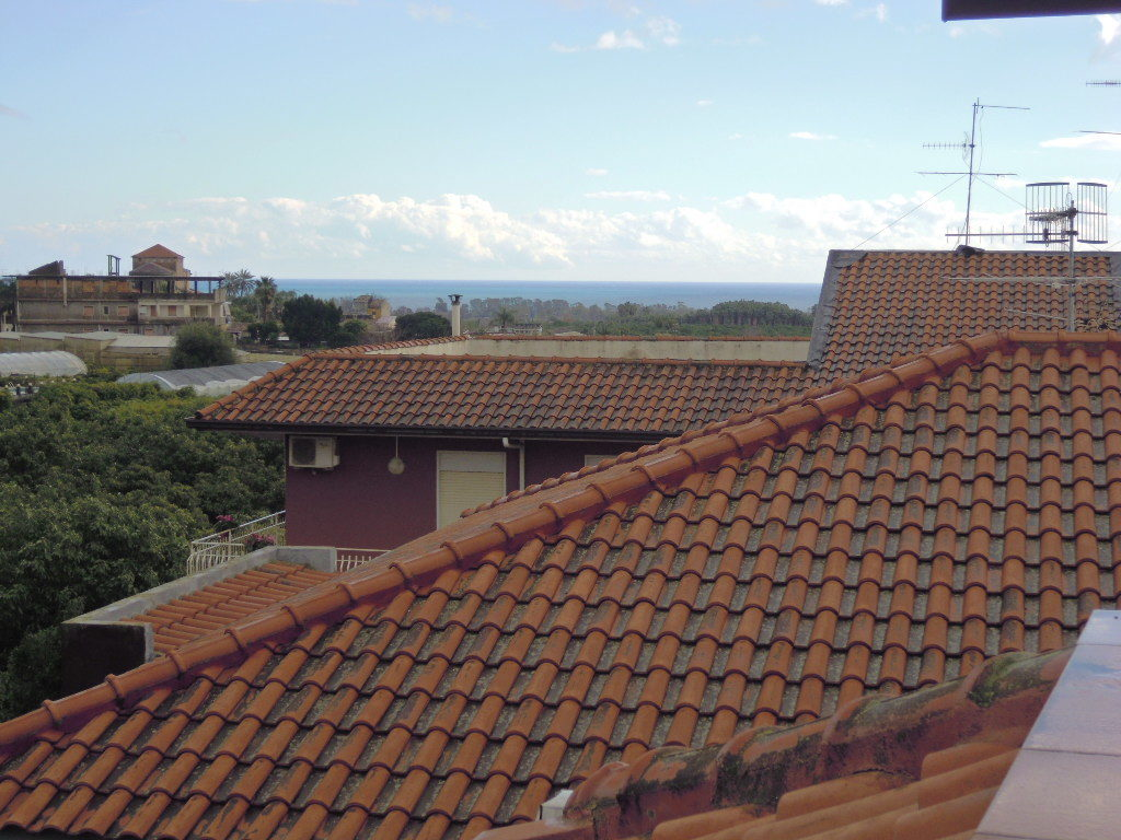 Appartamento pi mansarda terrazzata con vista e 2 garage for 2 box garage con appartamento